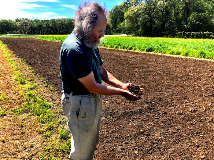 Heinz Thomet holding the soil at Next Step Produce in Maryland