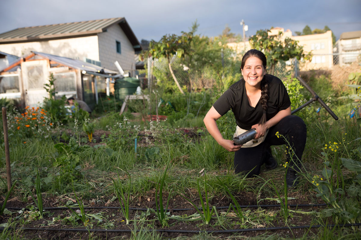 Aidee Guzman takes soil samples from the Berkeley Student Organic Garden. Credit: Sarah Craig for High Country News