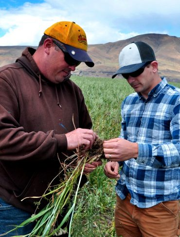 Oregon farmer Noah Williams works with the USDA NRCS to build healthier soil on his farm. (Photo CC-licensed by NRCS Oregon
