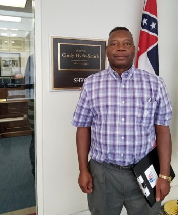 Carlton Sanders outside the office of Rep. Cindy Hyde-Smith (R-Miss.). (Photo credit: RAFI-USA)
