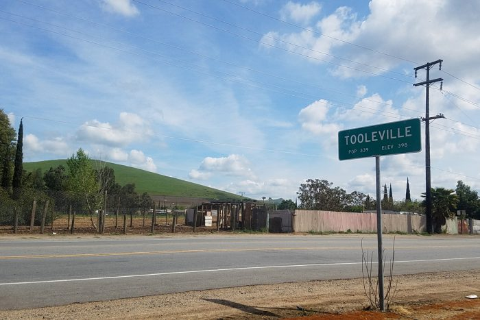 the sign for tooleville in the central valley of california