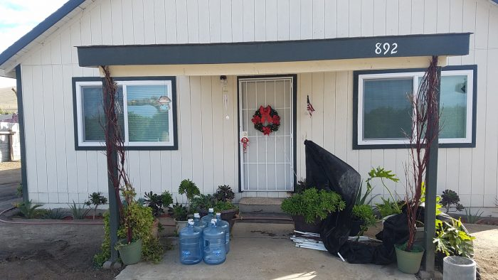 A delivery of 5-gallon water jugs outside a Tooleville resident's home. (Photo courtesy of the Leadership Counsel)