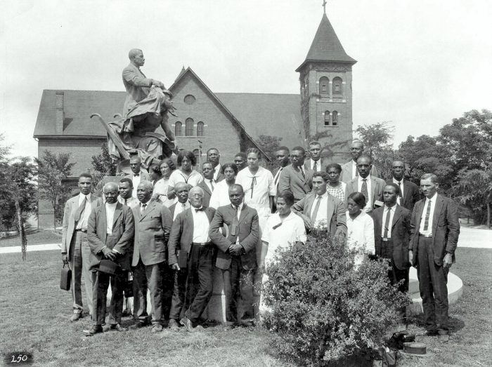 African-American farm and home demonstration agents posing under the Booker T. Washington statue on the Tuskegee Institute campus, July 15, 1925. (Photo courtesy Auburn University Libraries Special Collections and Archives.)
