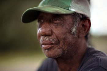 Lawton Wilburn takes a moment to rest in May 2019, on land he farms near Warwick, Georgia. Photo by Mike Kane for Marguerite Casey Foundation's Equal Voice News