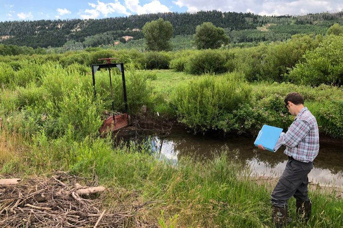 Charlie Ferrantelli with the Wyoming State Engineer's Office on a field visit to an SCPP participant's headgate. (Photo courtesy of Trout Unlimited)