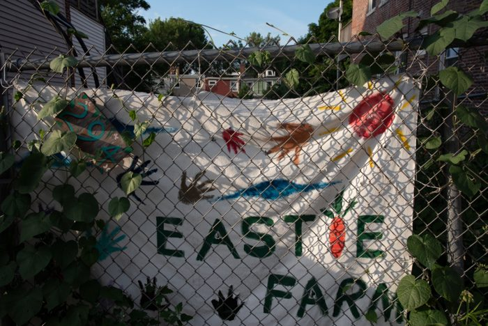 A community-made sign welcoming visitors to Eastie Farm.