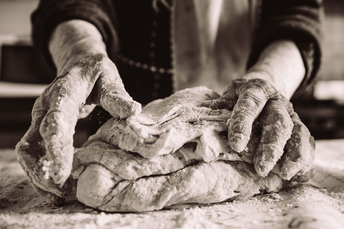 citizen scientist baking bread and kneading dough