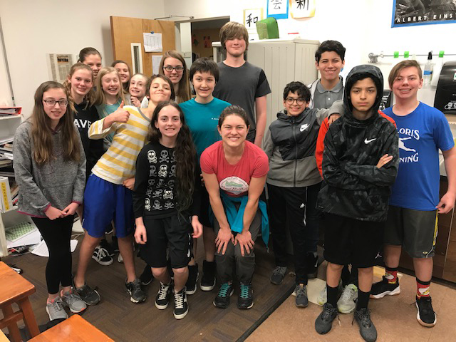 A group of 7th grade students from Exploris Middle School who participated in Sourdough for Science, an educational component of The Sourdough Project. Erin McKenney, one of the researchers and educators from the Rob Dunn Lab, is in the center. (Photo courtesy of the Rob Dunn Lab)