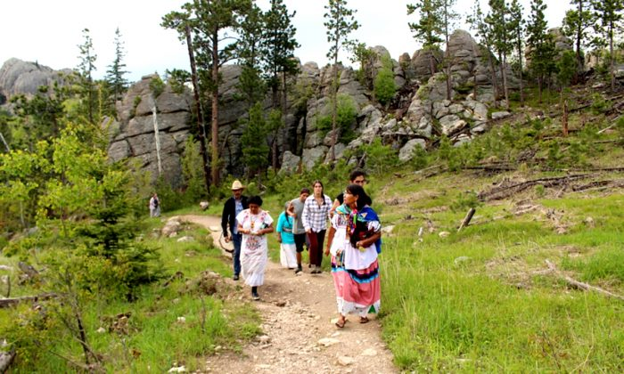 Cheryl Angel leads a group on pilgrimage at Black Elk Peak, one of four Lakota sacred sites that were visited during the Sovereign Sisters Gathering.