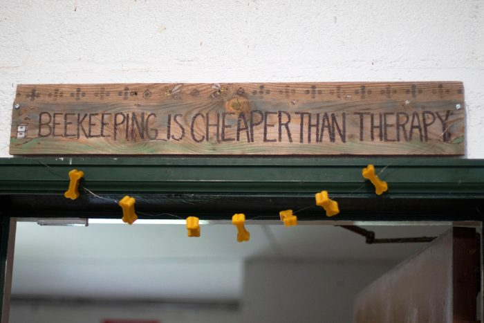 "sign reading ""beekeeping is cheaper than therapy"""
