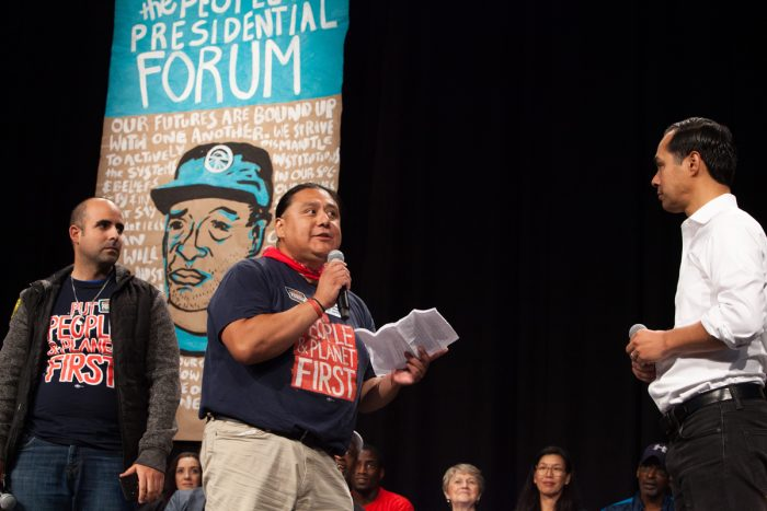 Sonny Garcia of the One People's Campaign asks Julián Castro a question about climate change and the Green New Deal. (Photo credit: Karla Conrad)