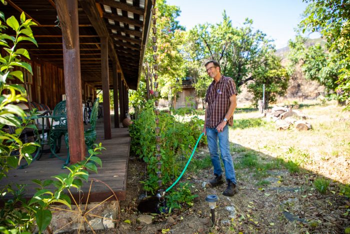 Kaisel tries to water plants around the house, but when PG&E cuts electricity, it effectively cuts water since he does not have a generator for his well pump.