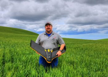 Robert Blair holding an eBee Ag drone. (Photo courtesy of Robert Blair)