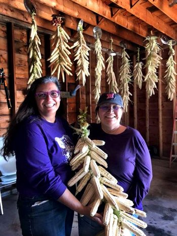 Laura Manthe and Michelle Webster displaying a corn braid.