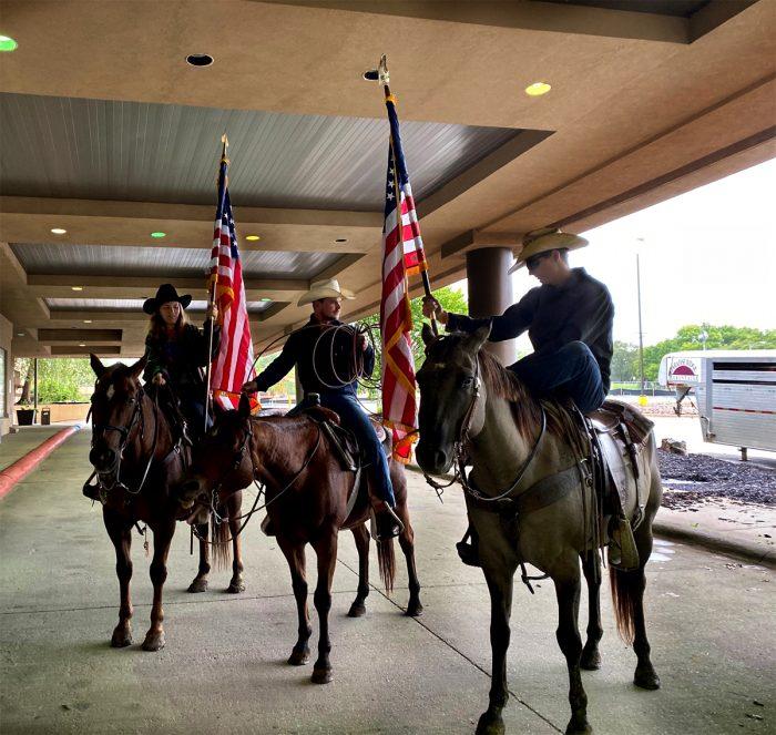 Ranchers Nicole Pfrang, Tyler Heiman, and Tyler Herrman road into the rally on horseback. (Photo courtesy of Angela Huffman.)