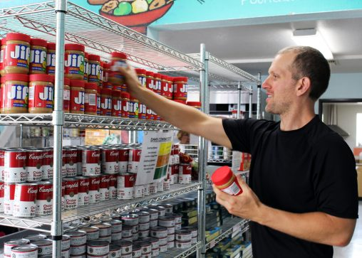Man shopping at a food bank to fight food insecurity and hunger.