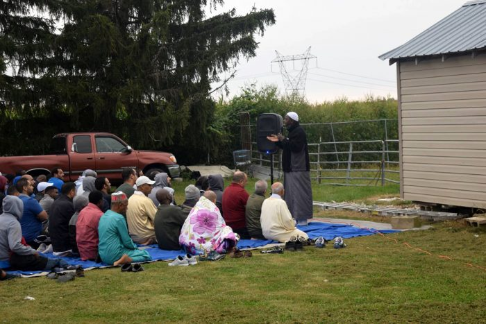 an imam leads a prayer at bismi allah farm