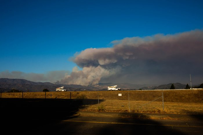 As of Sunday, more than 3,000 firefighters were battling the explosive Kincade Fire, and a broad swath of Sonoma County, from mountain to coast, was under evacuation orders. (Photo credit: Anna Maria Barry-Jester/KHN)