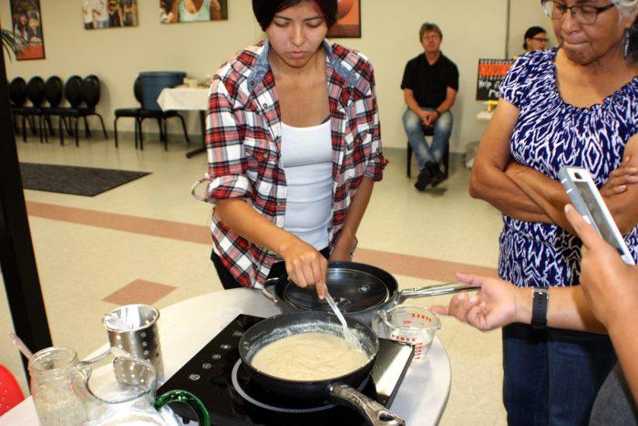 Cultural educators demonstrate ways of preparing acorn mush.
