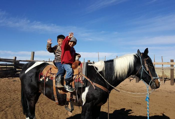 Terri Honani's family on horseback.