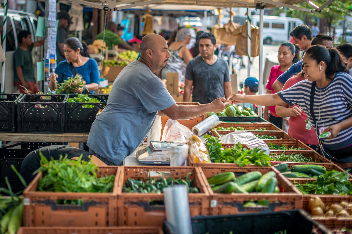Martin Rodriguez sells his vegetables at the Corona Farmers Market in Queens, New York, one of the most dynamic and diverse farmers markets in the city and is steps off the subway and mass transit system for the city. (USDA Photo by Preston Keres)
