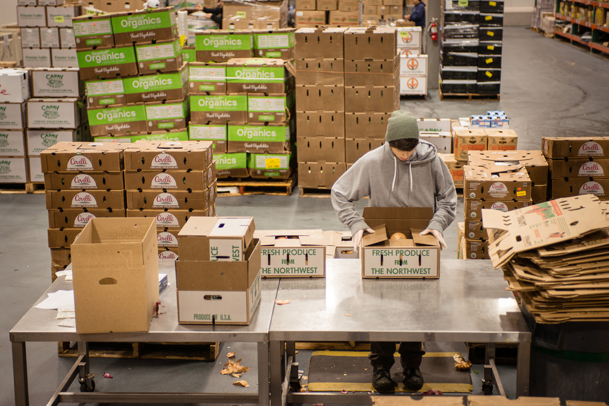 Packing produce in a warehouse. (Photo courtesy of The Organically Grown Company)