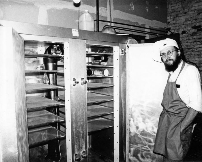 Seth Tibbott in front of his first tempeh incubator, in 1980. (Photo courtesy of Seth Tibbott)