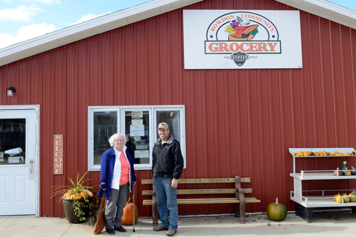 Laurel Jones and Larry Crowder outside the Bowdon Community Grocery.