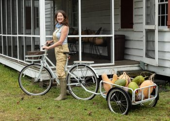 Sarah Ross and fresh grown produce. Photo by Bill Durrance.