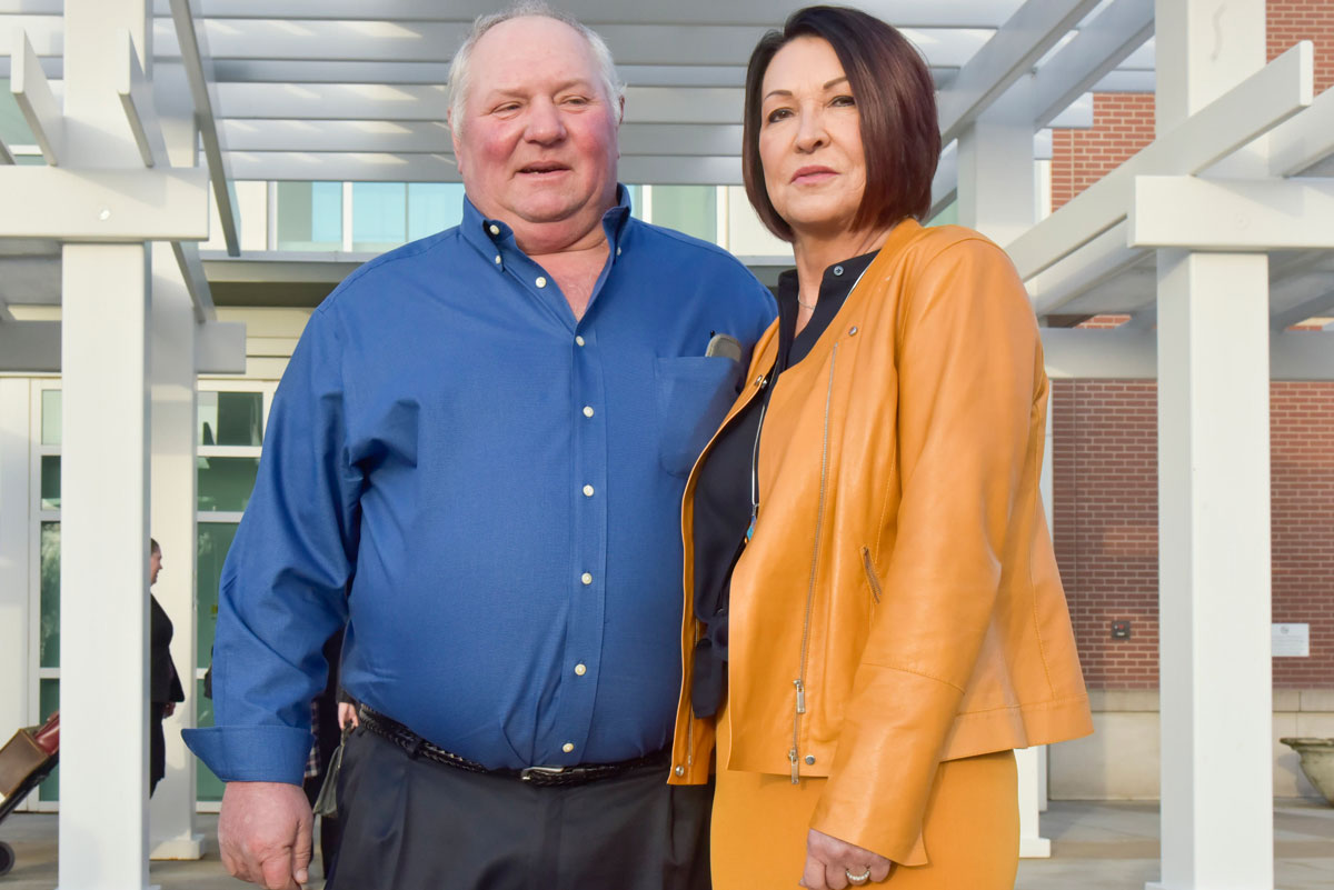 Bill Bader, owner of Bader Farms, and his wife Denise pose in front of the Rush Hudson Limbaugh Sr. United States Courthouse in Cape Girardeau, Missouri, on Monday, Jan. 27, 2020. (Photo by Johnathan Hettinger/Midwest Center for Investigative Reporting)