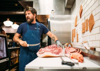 Grass & Bone's butcher, James Wayman, working in the kitchen.