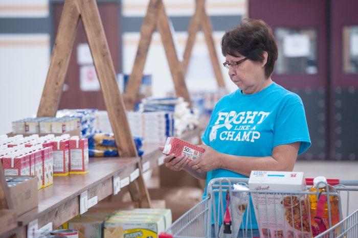 woman shopping for food at the spirit lake reservation grocery store