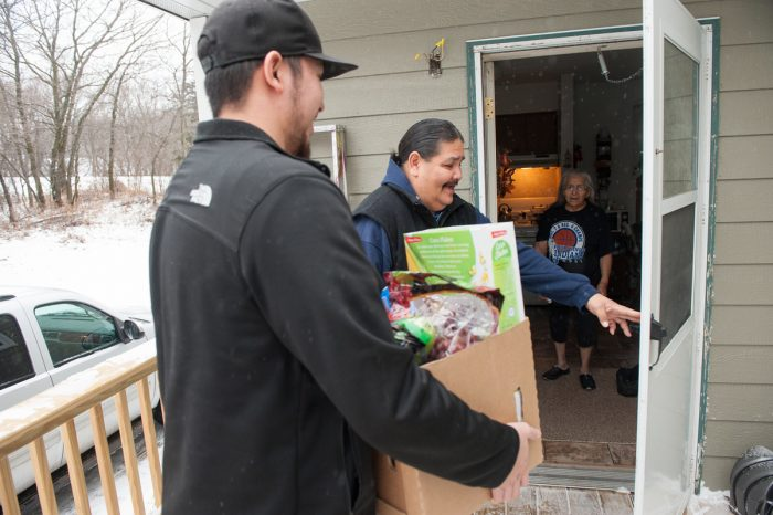 Spirit Lake Food Distribution Program on Indian Reservations (FDPIR) staff delivers the monthly food package to an elderly client's home on the Spirit Lake reservation in North Dakota. (Photo by Don Hamilton for USDA)