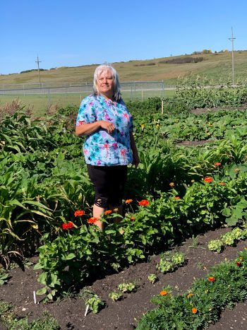 A resident of the spirit lake reservation tending her community garden. (Photo by Heidi Zeigenmeyer)