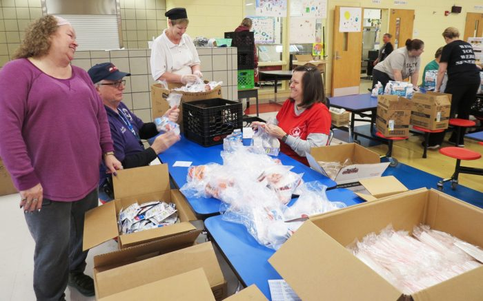 Volunteers filling food delivery boxes. Photo courtesy of Bullitt County Public Schools.