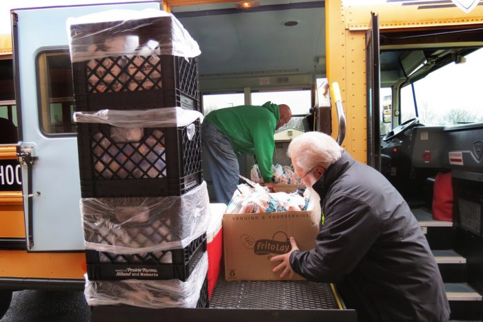 Volunteers loading up a school bus for rural food deliveries. Photo courtesy of Bullitt County Public Schools.