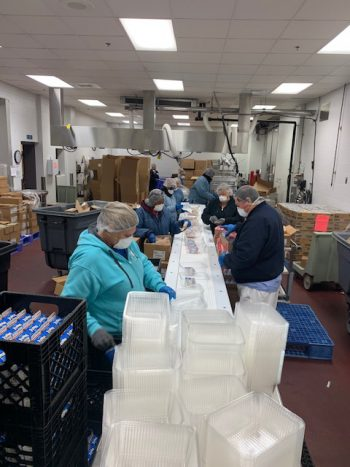 Filling Grab-and-go meals. (Photo courtesy of Jefferson County Public Schools)