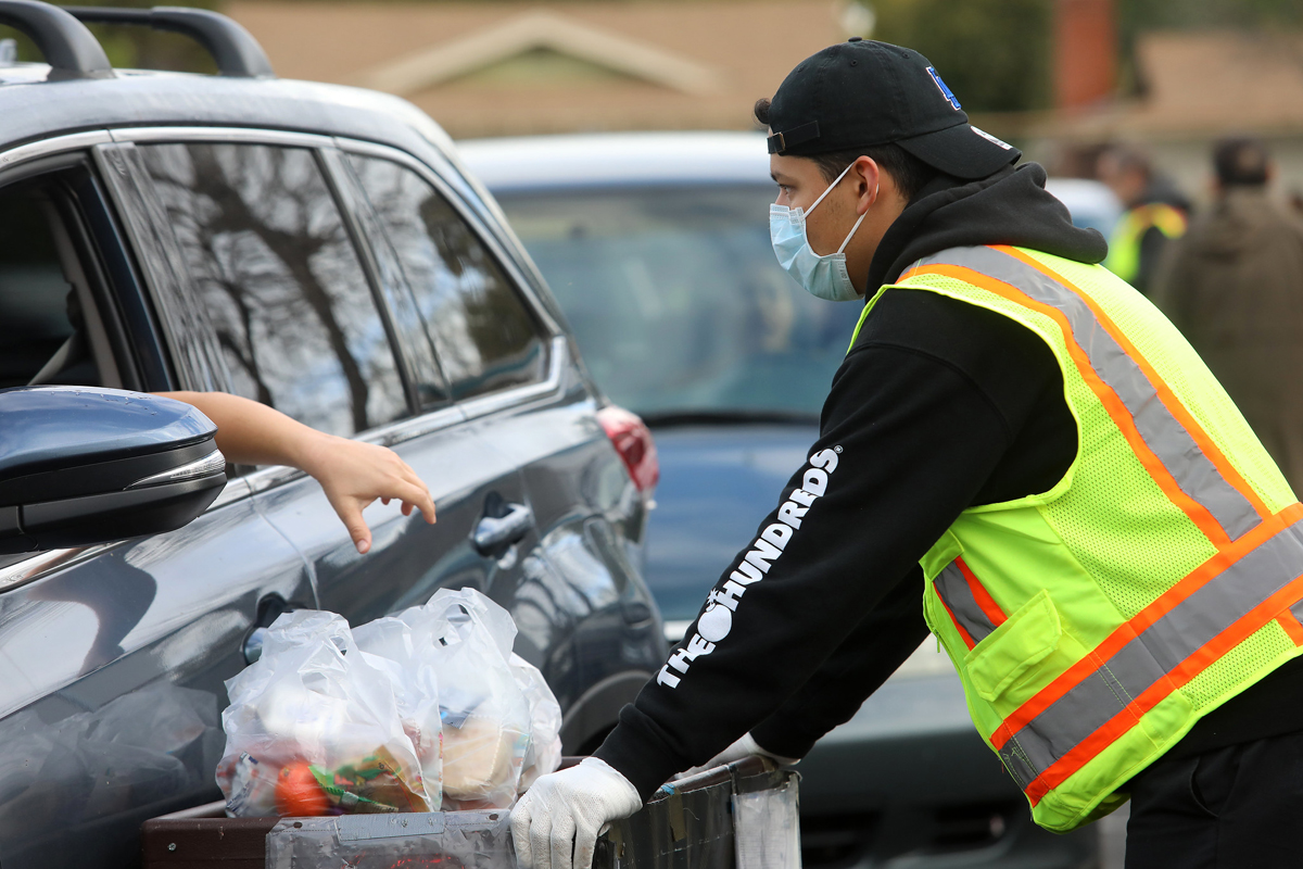 Brian Saucedo helps give out meals at Columbus Middle School in Canoga Park, Calif. on the second day of Grab and Go food distribution on March 19, 2020. (Photo: Jill Connelly/Red Cross LA)