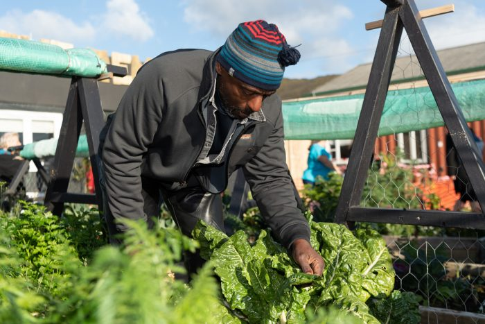 Ron Finley working in his urban farm. (Photo CC-licensed by the U.S. Embassy on Flickr)