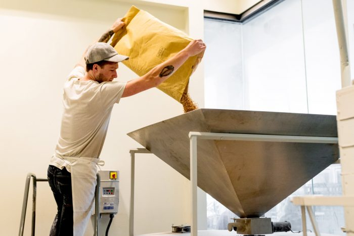 Milling wheat at Ibis Bakery in Kansas City. (Photo credit: Ryan James Carr)