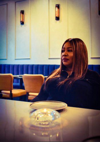 Nya Marshall sits in her restaurant, Ivy Kitchen. (Photo courtesy of Nya Marshall)