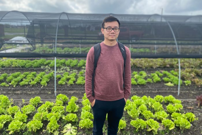 Khai Nguyen stands in the fields at Veggi Co-op farm in New Orleans. c