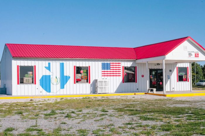 A closed storefront in Duplin County, with the U.S. and Guatemalan flags. Photo by Victoria Bouloubasis
