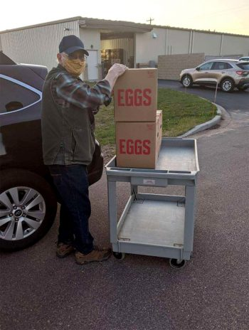 Bob Braun of Pigeon River Farm donates eggs to the Interfaith Food Pantry in Wisconsin. (Photo courtesy of Pigeon River Farm)