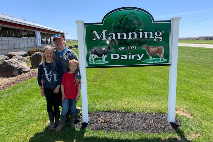 Rebecca Howrigan with her children outside her dairy in St. Albans, Vermont. (Photo courtesy of Manning Dairy)