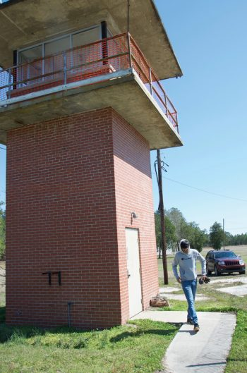 Robin Patel exits the former guard tower the youth plan to flip into a community climbing wall.
