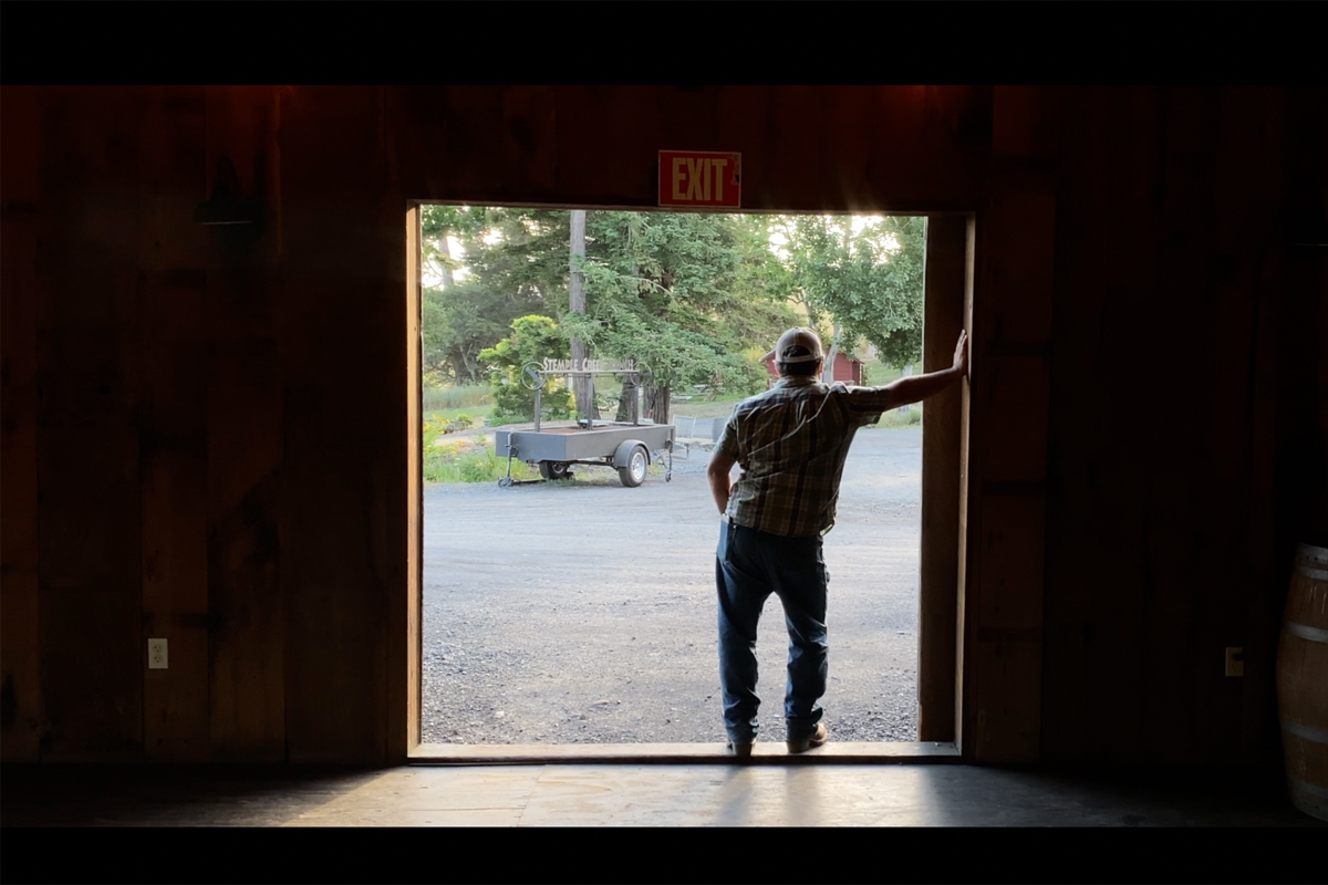 loren poncia stands in the doorway of his barn
