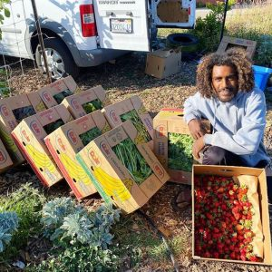 Jamil Burns of Raised Roots Farm in Oakland, shows off some of his produce destined for mutual aid for protesters seeking Black liberation.
