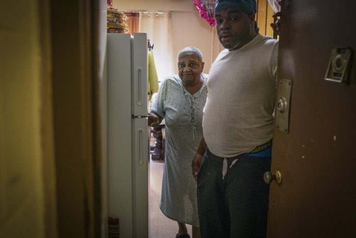 A son with his mother who received emergency meals in the South Bronx.