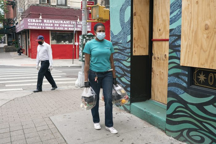 "Linda White delivers food on Manhattan's Lower East Side. During the protests, businesses were boarded up after nearby establishments were looted. Some of the streets were closed. ""Regardless of what's happening,"" she said, ""we're gonna make it work, even if we have to park three blocks down and have to walk. You gotta take the good and the bad. Not every day is gonna be smooth sailing."""